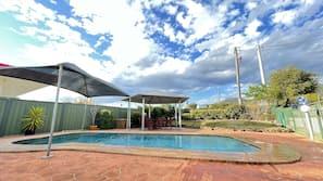 Seasonal outdoor pool, open 8:00 AM to 8:00 PM, free pool cabanas