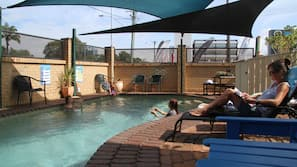 Outdoor pool, open 7:00 AM to 8:00 PM, pool umbrellas, pool loungers