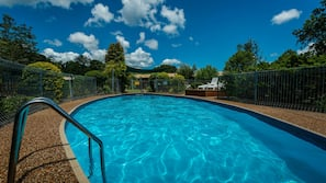 Outdoor pool, open 8:00 AM to 9:00 AM, pool umbrellas, pool loungers