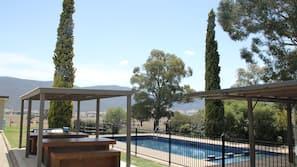 Seasonal outdoor pool, open 8:00 AM to 6:30 PM, sun loungers