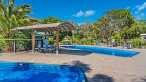 2 outdoor pools, open 8:00 AM to 8:00 PM, pool loungers