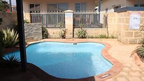 2 outdoor pools, open 7:30 AM to 7:00 PM, pool umbrellas, pool loungers