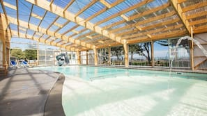 Indoor pool, open 10:00 AM to 8:00 PM, pool loungers