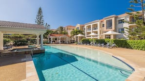 2 outdoor pools, pool umbrellas, pool loungers