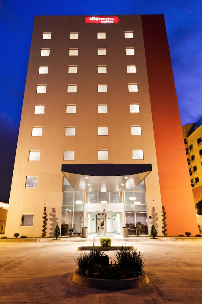 Front of Property - Evening/Night, City Suites Puebla FINSA