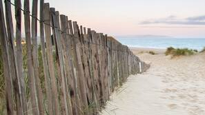 On the beach, fishing