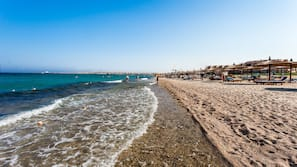 Private beach, beach towels, beach volleyball, beach bar