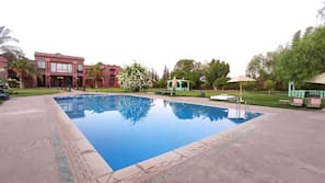 Outdoor pool, open 9:00 AM to 8:00 PM, pool umbrellas, pool loungers