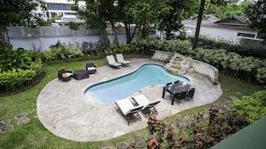 Outdoor pool, a waterfall pool, pool umbrellas, pool loungers