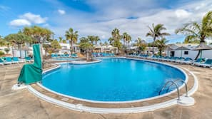 Outdoor pool, open 8 AM to 6 PM, pool umbrellas, pool loungers