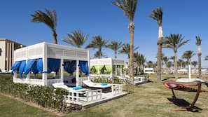 Private beach, free beach shuttle, beach cabanas, sun loungers