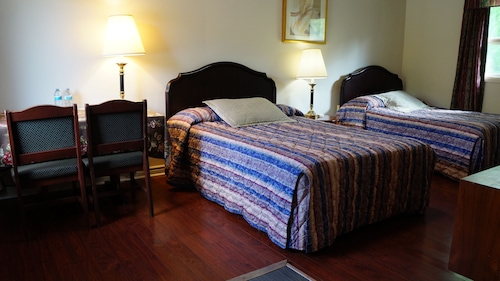 Check Expedia for Availability of Colonial Inn Motel