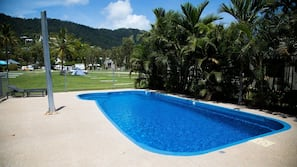 Outdoor pool, open 7:00 AM to 7:00 PM, pool loungers
