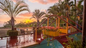 Outdoor pool, open 6:00 AM to midnight, pool loungers
