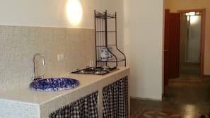 Full-size fridge, stovetop, coffee/tea maker, cookware/dishes/utensils