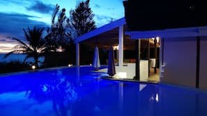 2 outdoor pools, an infinity pool, pool umbrellas, sun loungers
