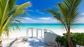 On the beach, white sand, sun loungers, snorkeling