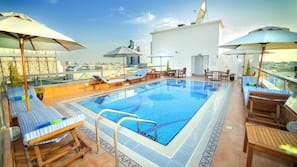 Outdoor pool, open 9:00 AM to 6:00 PM, pool umbrellas, pool loungers