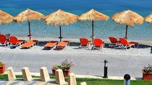 On the beach, sun loungers, beach umbrellas, fishing