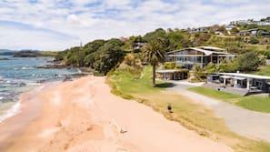 On the beach, sun-loungers, beach towels, windsurfing
