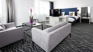 Luxe beddengoed, een gratis minibar, een kluis op de kamer, een bureau