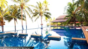 Outdoor pool, an infinity pool, pool loungers