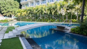 3 outdoor pools, open 7:00 AM to 10:00 PM, pool umbrellas, sun loungers