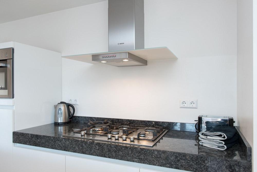 Cocina en la habitación urban apartments de laurier