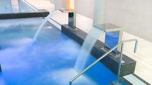 Indoor pool, open 6:00 AM to 10:00 PM, pool loungers, lifeguards on site
