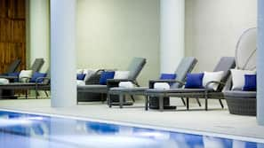 Indoor pool, open 2:00 PM to 10:00 PM, sun loungers, lifeguards on site