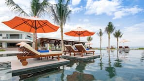 2 outdoor pools, open 6:00 AM to 7:00 PM, pool umbrellas