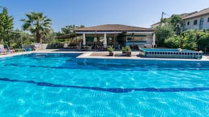 Outdoor pool, open 9 AM to 9 PM, pool umbrellas, pool loungers