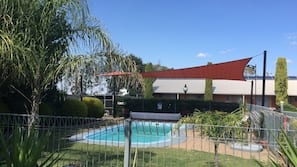 Outdoor pool, open 2:00 PM to 8:00 PM, pool loungers