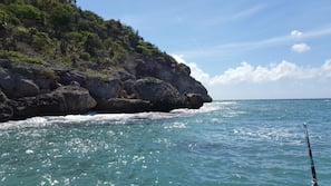 Beach nearby, white sand, snorkeling, motor boating