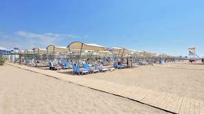 Private beach, sun loungers, beach umbrellas, beach bar