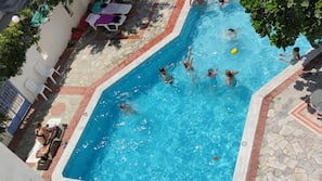 Seasonal outdoor pool, open 8 AM to 7:00 PM, pool umbrellas