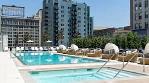 Outdoor pool, open 7 AM to 10 PM, free pool cabanas, pool loungers