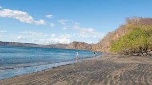On the beach, beach umbrellas, beach towels, beach massages