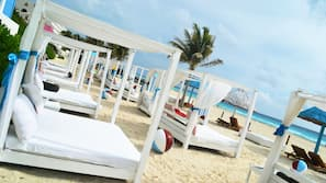 On the beach, white sand, free beach cabanas, sun-loungers