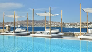 2 outdoor pools, open 9:00 AM to 7:00 PM, free cabanas, pool umbrellas