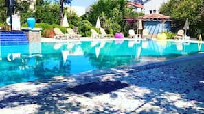 Seasonal outdoor pool, open 10:00 AM to 6:30 PM, pool umbrellas