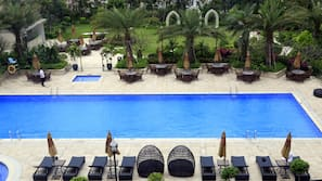 2 outdoor pools, open 7:00 AM to 11:00 PM, pool umbrellas