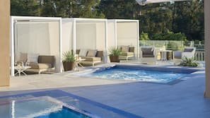Outdoor pool, open 6:00 AM to 10:00 PM, free pool cabanas