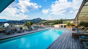 Seasonal outdoor pool, open 8:30 AM to 8:00 PM, pool loungers