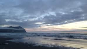 On the beach, sun loungers, beach towels, fishing