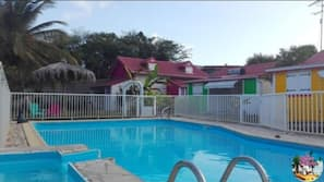 Outdoor pool, open 9:30 AM to 6 PM, pool loungers