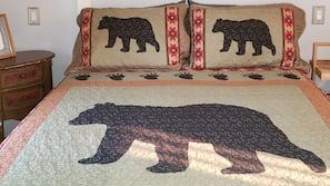 Colchones con acolchado adicional y tabla de planchar con plancha