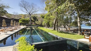 2 outdoor pools, an infinity pool, pool umbrellas