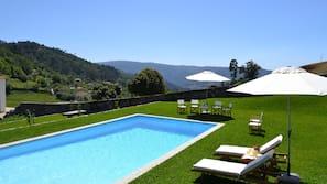 Seasonal outdoor pool, pool umbrellas, pool loungers