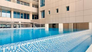 Outdoor pool, sun loungers, lifeguards on site